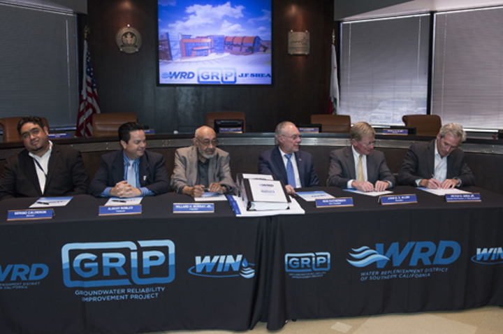 WRD Board of Directors and J.F. Shea Construction sign historic water project construction agreement.