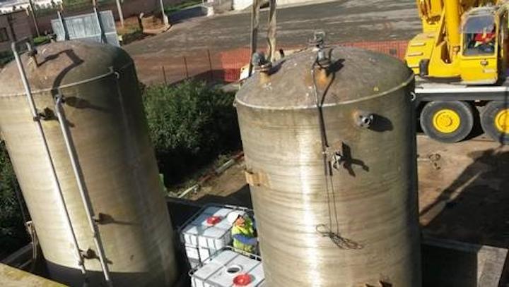 Biwater team removing chemical storage tank.