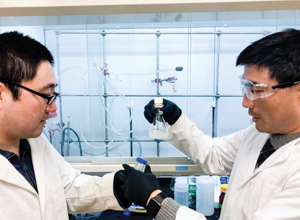 (L-R) Fei Zhao and Guihua Yu of Yu Research Labs at UT Austin examine a sample of their newly-developed hydrogel. Photo Courtesy Cockrell School of Engineering, The University of Texas at Austin.