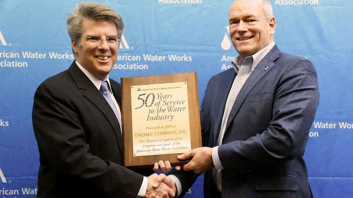 AWWA CEO David LaFrance (left) congratulates Randy Moore, Director of Sales-Agency Development and Industry Affairs and Vice President of the AWWA Board of Directors.