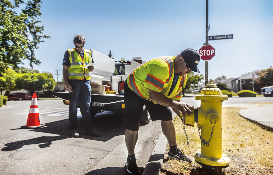 Workers install a smart hydrant equipped with multiple sensors in San Jose, Calif.
